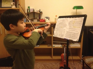 Lucian at violin class - determination is key here.